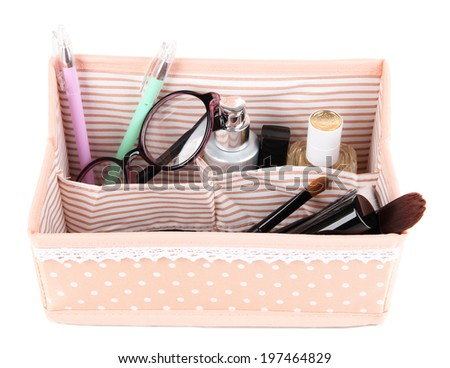 Colorful cosmetic bag with polka dots isolated on white - stock photo