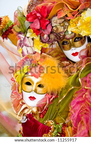 Colorful costume at the Venice Carnival - stock photo