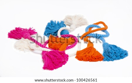 Colorful cotton tassels isolated on white - stock photo