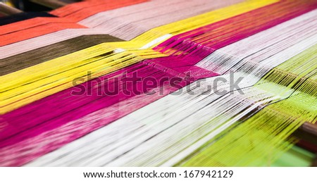 Colorful cotton thread in the weaver - stock photo