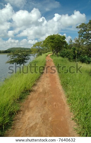 colorful countryside by the lake - stock photo
