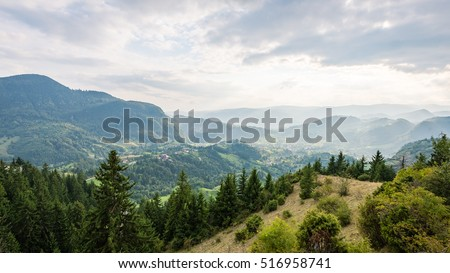 colorful countryside view in carpathians. mountains and trash on foreground