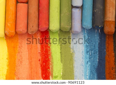colorful crayons creating rainbow - stock photo