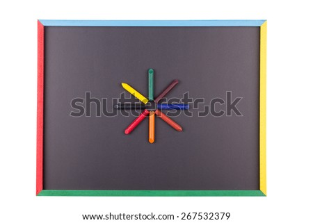 Colorful Crayons on an Isolated Blackboard. - stock photo
