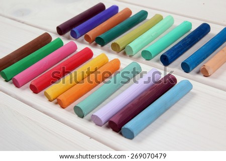 Colorful crayons on wood table - stock photo