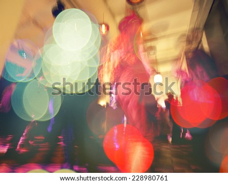 colorful crowd on concert,disco night ,dancing concept,party and night club background - stock photo