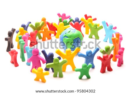 colorful crowd standing around planet earth to protect it - stock photo