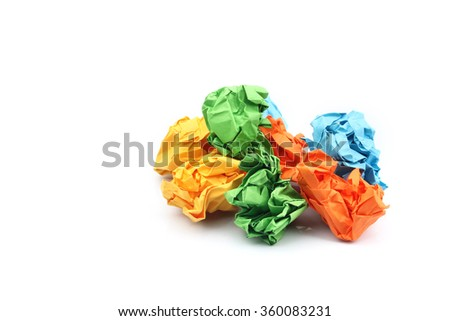 Colorful crumpled paper ball on white background