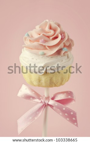 Colorful cupcake pops on pink - stock photo