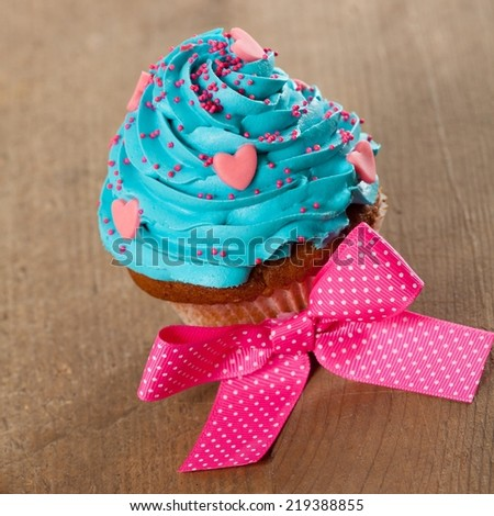 Colorful cupcake - shallow DOF. - stock photo