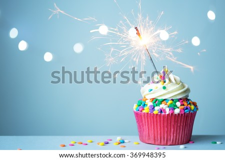 Colorful cupcake with sparkler - stock photo