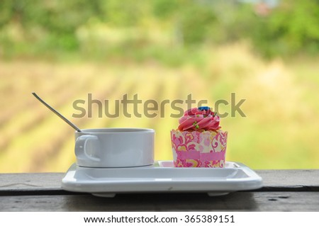 colorful cupcakes and coffee - stock photo