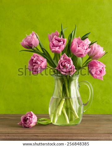 Colorful cupcakes and tulips - stock photo