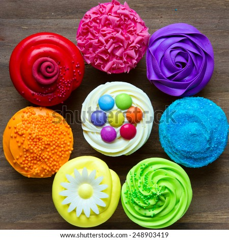 Colorful cupcakes in a circle - stock photo