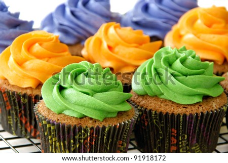 Colorful cupcakes, in Halloween cupcake liners - stock photo