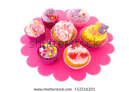 Colorful cupcakes on pink tray