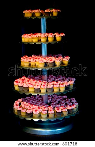 colorful cupcakes on tier - stock photo