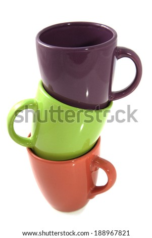 Colorful cups on a pile isolated over white