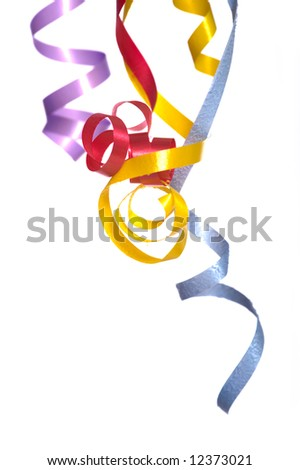 Colorful, curly, ribbon streamers on a white background with copy space - stock photo