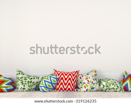 Colorful cushions on the background of a white wall  - stock photo
