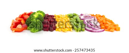 Colorful cut vegetables in a line with perspective isolated on white background - stock photo
