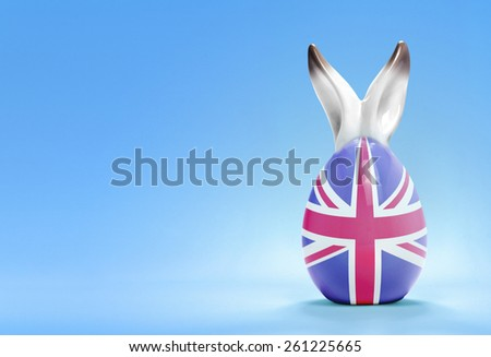 Colorful cute ceramic easter egg with rabbit ears and the flag of United Kingdom .(series) - stock photo