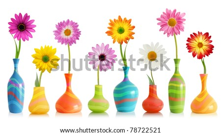 Colorful daisy flowers in bright vases isolated on white - stock photo