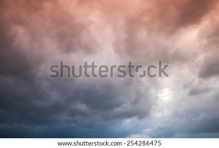 Colorful dark stormy cloudy sky. Natural photo background - stock photo