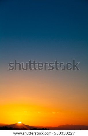 Colorful dawn over mountain in tropic location