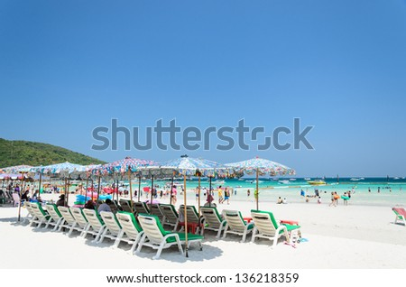 colorful deck chairs on the beach, sunrise time, koh lan, pattaya, thailand - stock photo