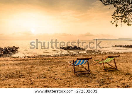 Colorful decks for relaxation on beach.
