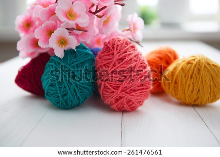 Colorful decorated easter eggs on white wood background. Happy Easter.