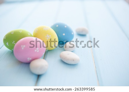 Colorful decorated easter eggs on white wood background. Happy Easter. - stock photo