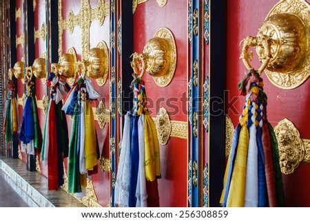 colorful decoration of the wall of buddhist temple in nepal - stock photo