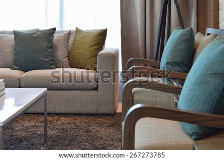 colorful decorative pillow on a casual sofa in living room - stock photo