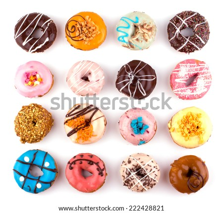 Colorful delicious donuts isolated on white background cutout - stock photo