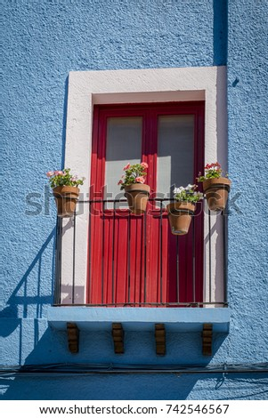 Colorful Detail Of Mexican Style And Architecture Bright Blue Wall White Door Frame
