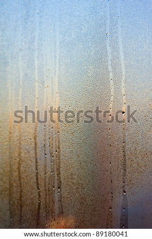 Colorful dew drops on the window surface - stock photo