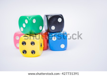 Colorful dices, Business risk by rolling the dice concept, chance, good luck or gambling isolated