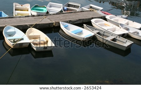 Colorful dingies tied in harbor on a bright morning; Ogonquit, Maine. - stock photo