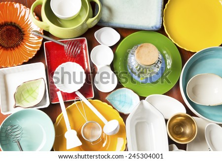 Colorful dishes and utensils close up - stock photo