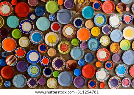 colorful dishes on the ceiling.