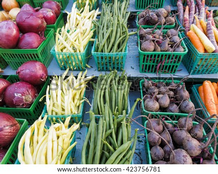 Colorful display of organic produce at Farmers Market - stock photo