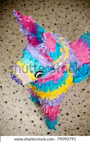 Colorful donkey pinata over blurred background