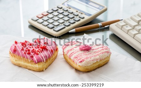 colorful donut in heart shape - stock photo