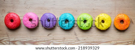 Colorful donuts in a row - stock photo