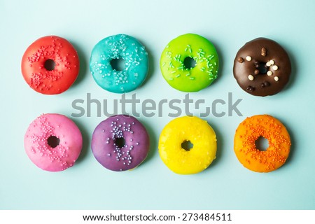 Colorful donuts on a blue background - stock photo