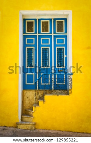Colorful door in an old colonial house in Havana - stock photo