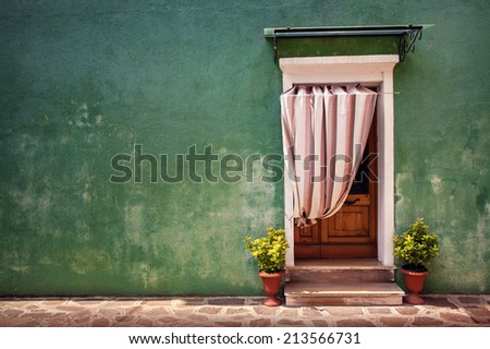 Colorful door of the home in Burano village - stock photo