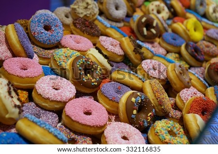 Colorful doughnut in Markthal, the hallargest indoor market in the Netherlands located in Rotterdam - stock photo